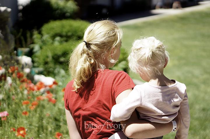 Teenage Babysitter holding a toddler