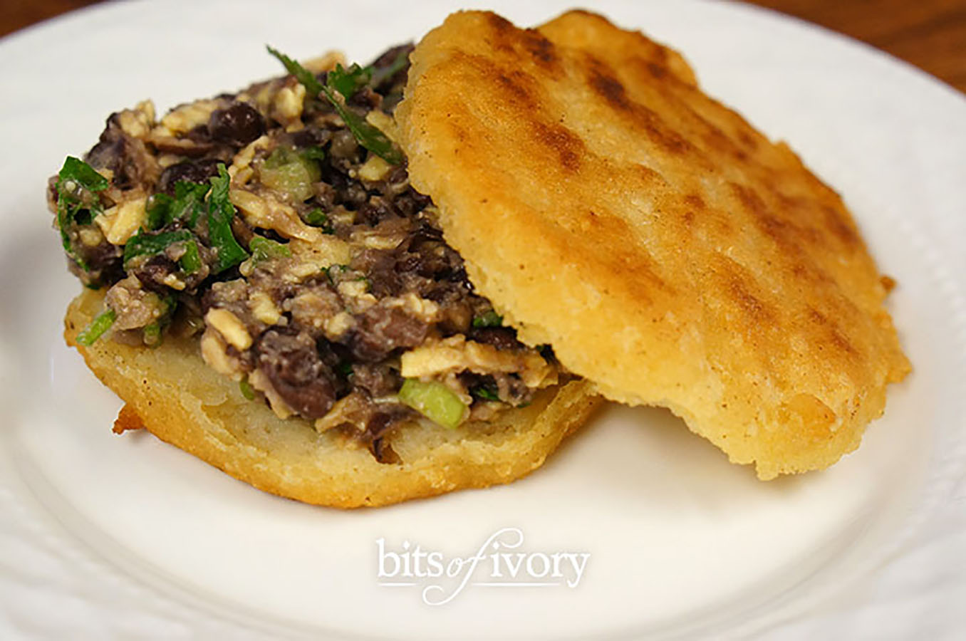 Arepas stuffed with fresh black bean filling | Venezuelan Corn Cakes - Arepas | www.bitsofivory.com