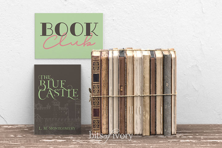 Book club sign with stack of books and cover of The Blue Castle by L. M. Montgomery