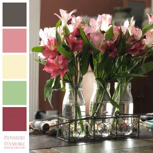 pink and red flowers in glass vases with color blocks for color inspiration, titled pensieri d'amore