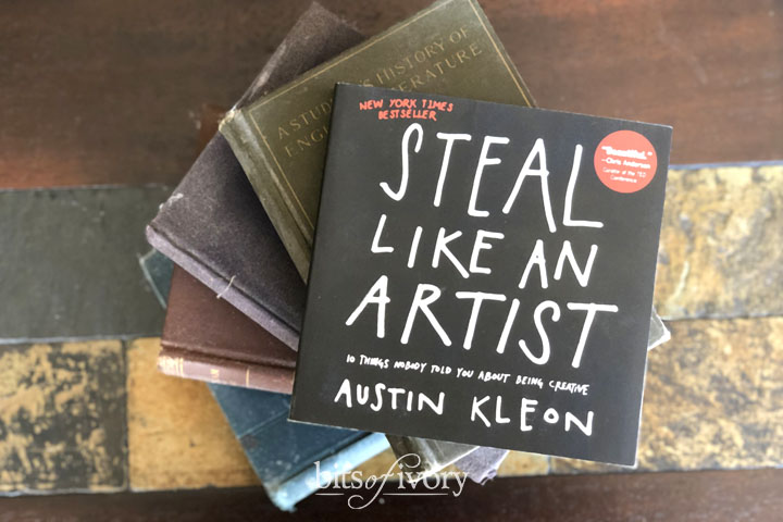 Steal Like an Artist Book by Austin Kleon on top of a stack of books