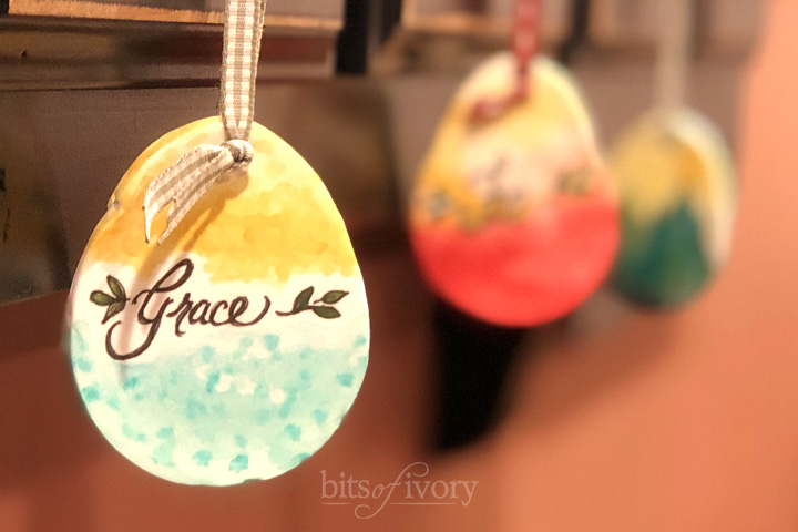 "Painted Easter egg ornament with ""Grace"" written on it."